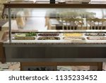 buffet trays and white plates | Shutterstock . vector #1135233452
