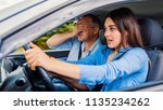 woman driver   car accident ... | Shutterstock . vector #1135234262