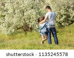 father with little daughter in... | Shutterstock . vector #1135245578