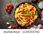 Pasta penne with chicken and vegetables.