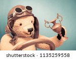 retro teddy bear toy in leather ...   Shutterstock . vector #1135259558