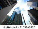 looking up at dramatic... | Shutterstock . vector #1135261382