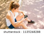 overhead view of young woman... | Shutterstock . vector #1135268288