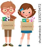 boy and girl holding boxes of... | Shutterstock .eps vector #1135273472