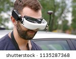 young man wearing fvp goggles.... | Shutterstock . vector #1135287368