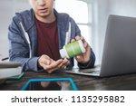 healthcare. serious young man... | Shutterstock . vector #1135295882