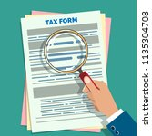 tax form audit. auditor hand... | Shutterstock .eps vector #1135304708