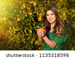 pretty young woman  outdoors at ... | Shutterstock . vector #1135318598