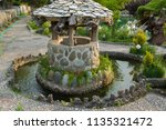 ancient stone well for water in ...   Shutterstock . vector #1135321472