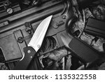 guns and pocket army knife ... | Shutterstock . vector #1135322558