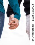 the hands of a woman and a man... | Shutterstock . vector #1135336925