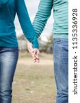 the hands of a woman and a man... | Shutterstock . vector #1135336928