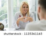doctor consulting male patient  ... | Shutterstock . vector #1135361165