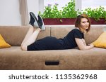 young beautiful woman lies on... | Shutterstock . vector #1135362968