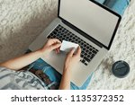 woman holding credit card for... | Shutterstock . vector #1135372352
