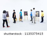 people are looking painting... | Shutterstock . vector #1135375415