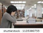 stressed asian student girl... | Shutterstock . vector #1135380755