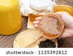scoby  hand holding tea... | Shutterstock . vector #1135392812