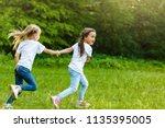 Two Little Girls Running Aroun...