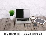 stylish workspace with computer ...   Shutterstock . vector #1135400615