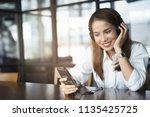 woman relaxing by listening...   Shutterstock . vector #1135425725