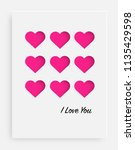 cut the pink heart on the paper ... | Shutterstock .eps vector #1135429598