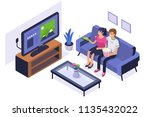 young family sitting on sofa... | Shutterstock .eps vector #1135432022
