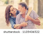 senior father embraced by his... | Shutterstock . vector #1135436522