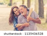 senior father embraced by his... | Shutterstock . vector #1135436528