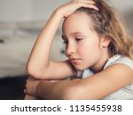 sad child at home. abuse.... | Shutterstock . vector #1135455938