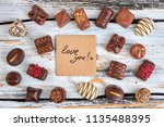 assorted chocolate candies on... | Shutterstock . vector #1135488395