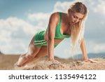 young beautiful woman doing... | Shutterstock . vector #1135494122