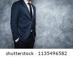 man in suit on a concrete wall... | Shutterstock . vector #1135496582