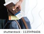 closeup of man holding... | Shutterstock . vector #1135496606