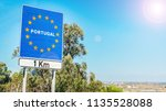 road sign on the border of a... | Shutterstock . vector #1135528088