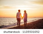 young happy couple on seashore... | Shutterstock . vector #1135531052