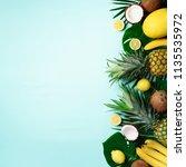 exotic pineapples  ripe... | Shutterstock . vector #1135535972