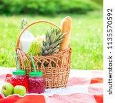 picnic basket  fruit  juice in... | Shutterstock . vector #1135570592