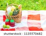picnic basket  fruit  juice in... | Shutterstock . vector #1135570682