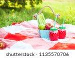 picnic basket  fruit  juice in... | Shutterstock . vector #1135570706