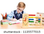 school child writing in... | Shutterstock . vector #1135577015