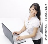 young woman typing text on... | Shutterstock . vector #1135601375