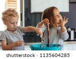little boy and girl mixing... | Shutterstock . vector #1135604285