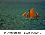 a lone sailing ship heading for ... | Shutterstock . vector #1135605242