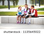 happy children girls girlfriend ... | Shutterstock . vector #1135645022