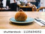 chocolate cream filled donut | Shutterstock . vector #1135654052