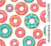 donut seamless pattern. pink...   Shutterstock .eps vector #1135667498