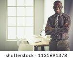 portrait of an handsome black... | Shutterstock . vector #1135691378
