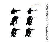 man with gun icon.vector... | Shutterstock .eps vector #1135695602
