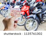 man holding money have a... | Shutterstock . vector #1135761302